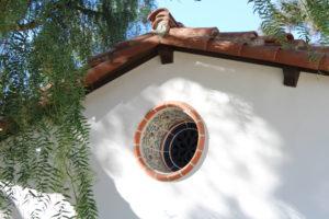 Porthole window with Malibu Potteries Tile, spanish coloial revival style